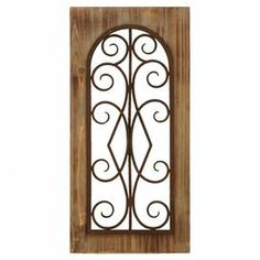 """Create an elegant focal point in your living room or hallway with this eye-catching metal and wood wall decor, showcasing scrollwork details and a tan finish.   Product: Wall decorConstruction Material: Metal and woodColor: TanDimensions: 23"""" H x 11"""" W x 2"""" D"""