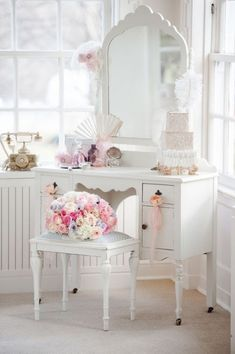 I love a beautiful vanity...and this one is so sweet painted white Will keep my eyes open at flea markets this summer :-)