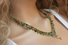 Green nylon Cord , 4mm CZ glass beads , crystal and 18k doubleside dragonfly charm Boho Crochet bracelet made extra long for you to wear it many ways. wraps about 5 times around the wrist or twice around your neck.. or as a long necklace.  The length is; approx 35 inches  Please contact me for measures and more questions…  Very easy to wear because they are so lightweight , versatile, and virtually indestructible with regular everyday wear! This piece is waterproof. Perfect for the beach…
