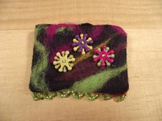 Punched wool and beaded pin brooch by EuthymicThreads on Etsy