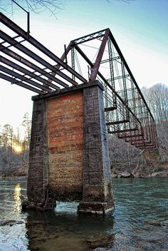 Settles Bridge was an iron and wood truss bridge completed in 1896. The bridge was abandoned in the 1950's after the wooden flooring rotted away and newer bridges were constructed at SR 20 and McGinnis Ferry Road. [by Greg Foster Photography]