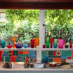 Want this colourful kitchen. random odds&ends for a backsplash