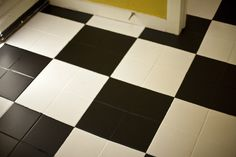Black and white checkerboard floors are classic and you can create them without setting a single tile. I transformed my tile entry way with paint and you c