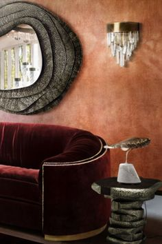 This sophisticated living room has the WALES Sofa, KUMI Round Mirror, LATZA Side Table, NAICCA Wall Light and the rug Snake 8.