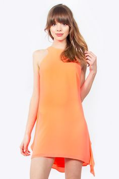 Fun and festive neon coral shift dress. Pair it with delicate accessories and nude heels to complete the look. - Neon coral shift dress - Cascading ruffle detail in the back - Button closure on back F