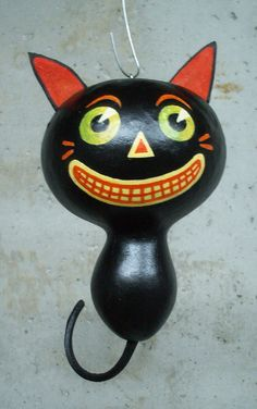 small black cat gourd  Artist Please?  Could easily make into birdhouse for outside the kitchen window.