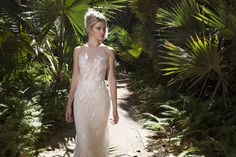 Dreamy ivory branch embroidered tulle over nude and blush lining, fit to flare dress with a breathtaking train to follow