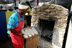 Baking bread in outdoor oven.