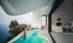 Three Evocatively Edgy Houses Push the Notion of Indoor/Outdoor Living to the ExtremeBy GilBartolomé Architecture in Granada, Spain. Gaudi, Zinc Roof, Hillside House, Cliff House, Villa, Spanish House, Interior Design Magazine, Indoor Outdoor Living, Cool Pools