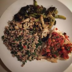 Oven baked halibut with a roasted tomato salsa roasted broccoli and cauliflower and ancient grain tabbouleh. #cleaneating #foodie #bonappetit