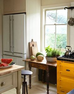 Trend Watch:  Is White the New Stainless Steel? And see the goldenrod playing peekaboo?  Swoon!