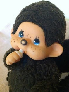 "Monchichi.  i had this as a little girl and my mom said i carried it everywhere until one day i threw it out the window of the car.  She tried to find it but couldn't and when she bought me a new one i told her it was not my ""monkey"" LOL.  The things we do as kids"