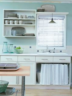 Love the look of the curtain..I would try this in a bathroom over open cabinets. Instant upgade!