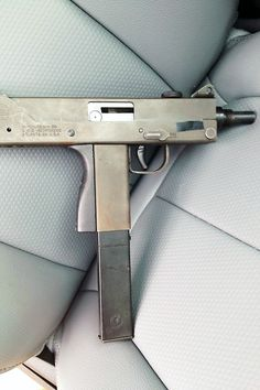 In the NRA's New America, we'll all carry a Mac 11 on the seat next to us, and when someone cuts us off in traffic we'll send them and their whole family to hell. Then claim we were standing on the ground, go home and watch TV. Weapons Guns, Airsoft Guns, Guns And Ammo, Rifles, Mac 11, Homemade Weapons, Submachine Gun, Moon Photography, Self Defense