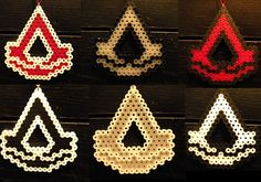 Assassin's Creed Perler Bead Sprite Logo Ornament by HouseOfHielo Perler Bead Designs, Perler Bead Templates, Hama Beads Design, Hama Beads Patterns, Perler Bead Art, Beading Patterns, Hamma Beads Ideas, Pixel Art, 8bit Art