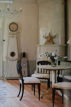 Traditional Mora clock and kakelugn (corner stove/fireplace).  #laylagrayce #swedish #interiordesign