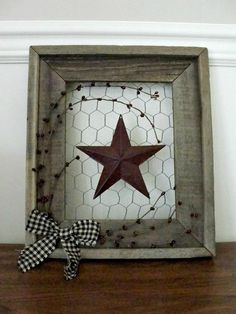 15 - Barnwood framed burgundy barn star on chicken wire with burgundy pip berries and black gingham bow. Measures 14 x 12 Picture Frame Wreath, Picture Frame Crafts, Wood Picture Frames, Picture On Wood, Chicken Wire Crafts, Chicken Wire Frame, Barn Wood Crafts, Barn Wood Projects, Metal Crafts