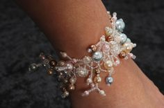 Pearly Dew Bracelet - Tute shows chevron stitch embellished with fringe.  Easy. ~ Seed Bead Tutorials