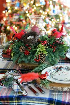 Christmas table by the tree with tartan plaid and hurricane centerpiece with evergreens and Cardinals | homeiswheretheboatis.net #Christmas #tablescape #LynchCreekFarm