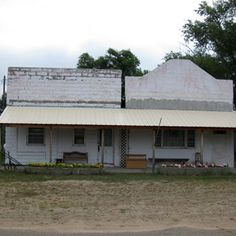 East side of main street, Brewster, Nebraska September 7, 2009. Gwen and Gertrude Neubauer, and Elsie Pickering lived on the right and the building beside was old Brewster Bank.