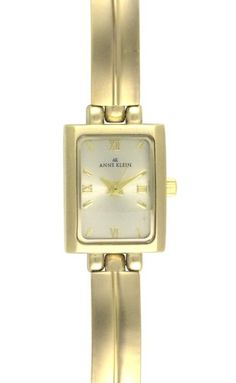 Anne Klein Women's 10-5404CHGB Gold-Tone Dress Watch  Beautiful brass defines this elegant Anne Klein watch. As gorgeous on your wrist as a slender bracelet, this timepiece shines with a uniquely sculpted brass band and square brass case accented by a rounded bezel. Offsetting the shimmery, champagne-colored dial are a combination of gold-tone Roman numerals and stick hour indicators that match the delicate hands and pin. Certain to remain as fashionable years from now as it is today..