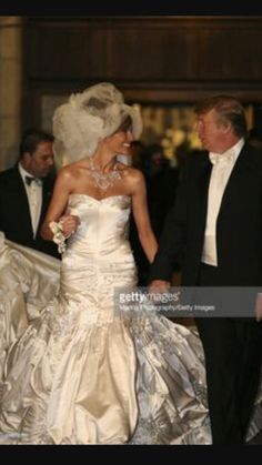 . Look at that dress. He's gained about 80 lbs. Have another coke.