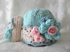 baby knitted hats | Hand Knitted Baby Hat with Ivory Lace and Flowers in Blues and Pink ...