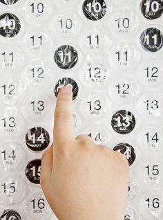 It's a regular calendar, but you could make a bubble wrap advent calendar, too.