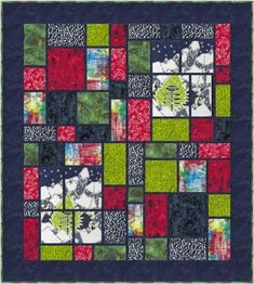 """Combine a 13"""" wide x 16"""" high mini panel or large focus print with 7 coordinates in a stained-glass type quilt in one of 3 sizes. Fabrics shown in the sample quilt are from Banyan Batik's Elevation collection. finished Sizes: Wall 28 1/2"""" x 31 1/2"""" Lap 52"""""""" x 58"""" Throw/Twin 75 1/2"""" x 84 1/2"""" Skill Level: Advanced Beginner/Intermediate Technique: Pieced Apres Ski, Panel Quilts, Fabric Panels, Quilt Patterns, Stained Glass, Skiing, Blanket, Prints, Layouts"""