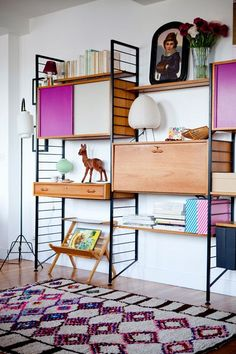 Love this colorful shelving unit.