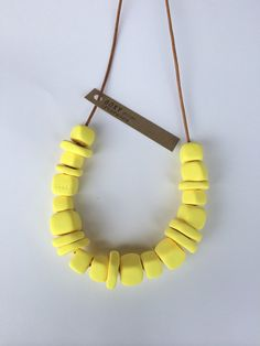 This is the AFTERGLOW necklace. It is a handmade Boxy FORM necklace. It is made of 22 handcrafted signature square and flat beads.    Boxy