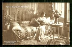 Sophie, Princess Consort of Albania (1885-1936), playing a guitar. Sophie was born a princess of Schonburg-Waldenburg, a territory that had become part of Germany.  Sophie married Prince William of Wied, also a prince of a principality that no longer existed. The fortunes of these two ghost royals looked up when William was selected to be king of Albania in 1914.  Later that year, with the outbreak of WWI the royal couple fled Albania never to return.