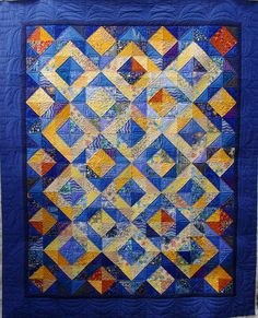Blue & Lemon Diamonds Quilt  The quilt I am featuring today has been made by my friend Tiana.  Tiana has made a beautiful and very effective half square triangle quilt resulting in a lay-out of blue and yellow diamonds.