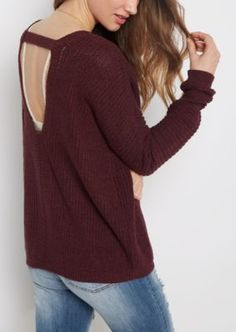 Find comfort in the little things with this soft and casual sweater. Made of heavy knit, it's cut with an open V-cut back.