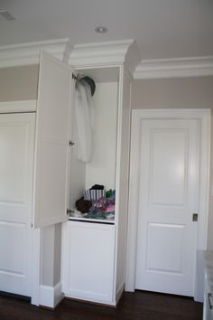 Must have laundry chute! I love the idea of it all landing in a cabinet until you are ready to sort.