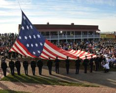 A replica of the original Star-Spangled Banner is hoisted during the Dawn's Early Light Ceremony at Fort McHenry in Baltimore, Sept. 14, 2014. The ceremony commemorates the date and time 200 years ago that Francis Scott Key was inspired to write the words that would become the national anthem. U.S. Coast Guard photo by Petty Officer 1st Class Pamela J. Boehland