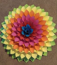 Rainbow paper wreath by MaddHatterStudio on Etsy