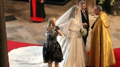 It was one of the iconic moments of the Royal wedding: Kate Middleton entering Westminster Abbey, assisted by her sister Pippa, while dress designer Sarah Burton ensured the gown was sitting perfectly. Kate Middleton Wedding Dress, Kate Middleton Photos, Pippa Middleton, William Kate Wedding, Prince William And Catherine, Prince Philip, Royal Wedding 2011, Royal Weddings, Royal Brides