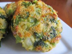 BAKED CHEESE & BROCCOLI PATTIES -(8)-INGREDIENTS   2 teaspoons vegetable oil   2 cloves garlic - minced  1/2 onion - chopped  1 (12 ounce) bag frozen broccoli - defrosted  3/4 cup panko breadcrumbs   1/2 cup sharp light cheddar cheese   1/3 cup parmesan cheese   2 eggs - beaten (can use whites for healthier version)  salt/pepper   (directions in comments below)