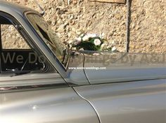 Vintage Wedding Lake Garda Romantic vintage floral composition on the silver wedding car...