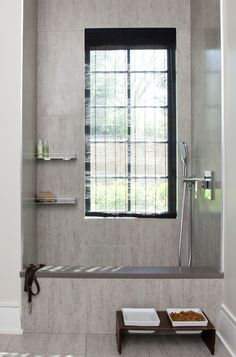 Think about storage for supplies. Just like a human shower area, this one has handy shelves for dog shampoo and sponges.