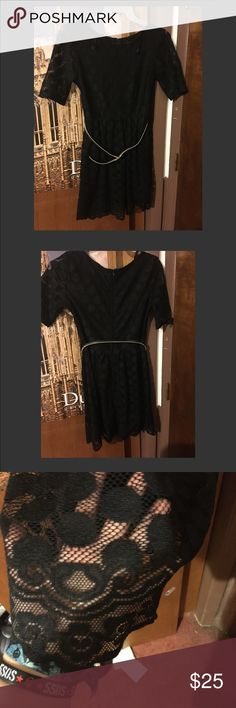 Classy Black Dress with gold belt  LIKE NEW Like new classy black two layer dress with a gold belt!! The inner layer is a thick solid black slip and the outer layer is a thin black layer with a circular pattern! It zips in the back. It's in EXCELLENT condition, only worn twice! I'm open to offers :) Dresses