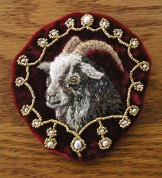 hand-embroidered regal velvet goat appliqué with freshwater pearls. For the person who has everything! Cor