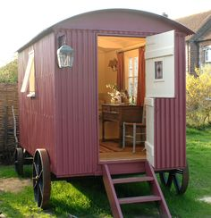 A delightful tiny home, beautiful colors and interior.  Love the shepherd hut wheels.