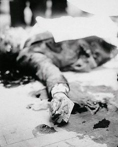 """A picture of Joe Masseria, a mob boss, taken in 1931 after being murder by supposed Charles """"Lucky"""" Luciano's hitmen. A photographer decided to stage the crime scene and take the ace of spades card that Masseria was playing with before his murder, and put it in his hands. Since then, the mob has always thought the Ace of Spades as a bad omen."""