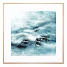 Conjuring imagery of snowy seas, this serenely designed print is a lush accent for your home or office.