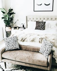 There are so many cool textures in this space! The bedding, blanket, and thrown pillows are all different comfy textures
