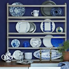 Display dishes against a deep #blue wall.