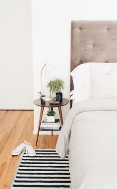 We love the mix of white and grey neutrals! Plus this striped rug adds the needed pop of something to the room.