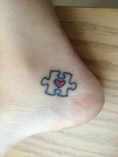 My autism awareness tattoo. Puzzle piece with a heart inside on inner ankle! Freshly done by Geoff Horn at Hole in the Sky Tattoo.